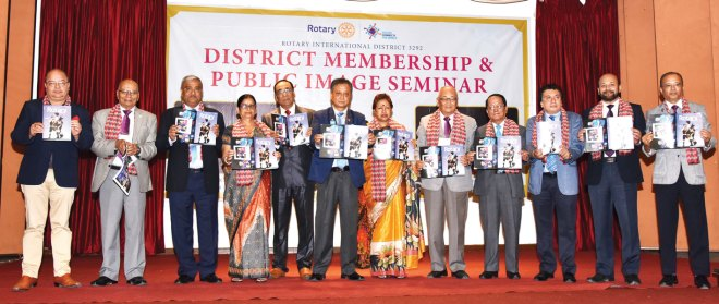 DG Kiran Lal Shrestha and other past governors of RID 3292 at the launch of Rotary News magazine in Nepal. PDG Swapan Choudhury (fifth from L), RID 3240, is also in the picture.