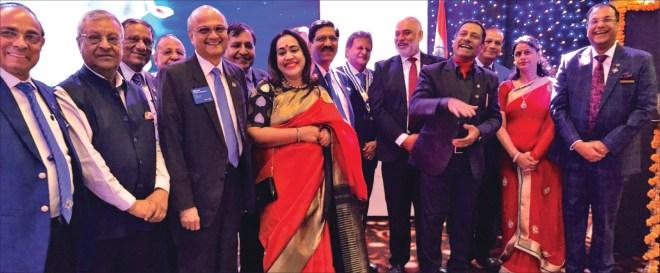 DG Deepak Gupta (R) with RC Bangalore Orchards past president D Ravishankar and Paola, and TRF Trustee Gulam Vahanvaty. PDGs J K Gaur, Rupak Jain, Ramesh Aggarwal, Sharat Jain and Subhash Jain are also seen.