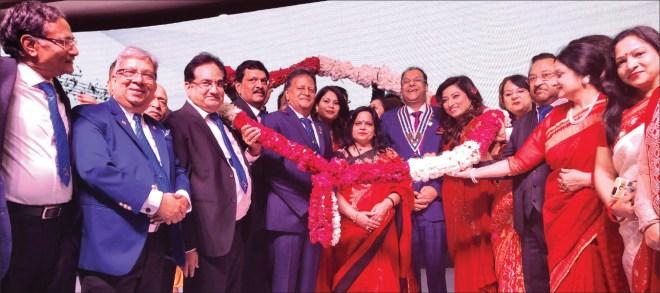 Incoming governor Deepak Gupta and his wife Reena, and IPDG Subhash Jain and his wife Babita being felicitated.
