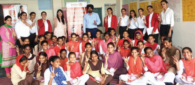 Rotaract Club of Austin Institutes Trainer Ajit Paul Singh Naphrey and Rtr Deepika Sharma (to his right) along with the government school girls.