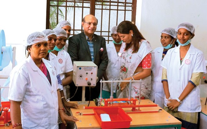 RID Kamal Sanghvi and Rtn Sugirda Nishanth, along with speech and hearing-impaired girls, at the Vocational Centre.