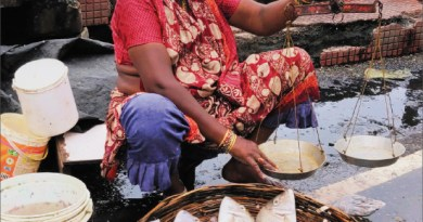 The woman selling fish by the jetty.