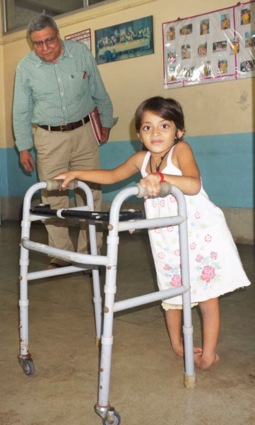 Rtn Amit Ghosh looks on as a child walks at the Howrah South Point Home.