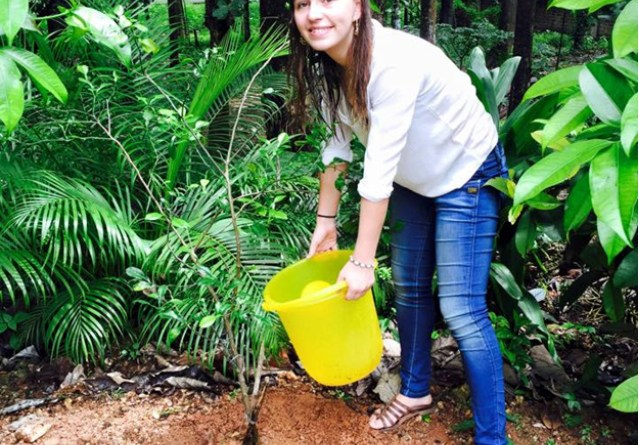 Margot Lassagne, an Exchange student from Toulouse, France, planting a sapling. Her grandfather Philippe Guillion funded a limb camp in 2004.