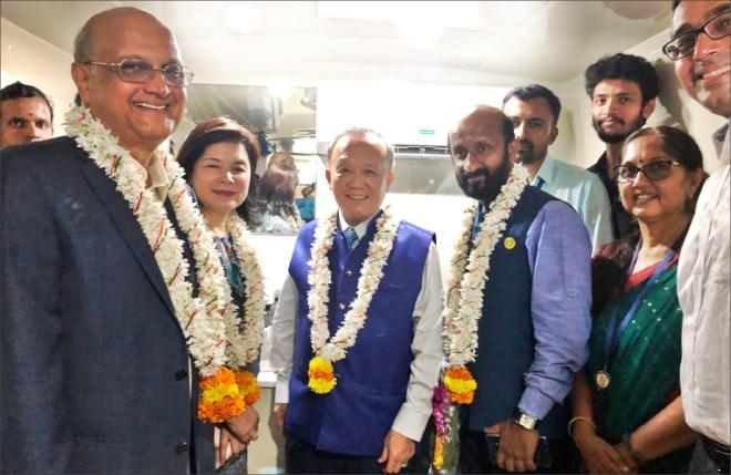 Trustee Vahanvaty, Corinna, Trustee Chair Gary and DG Madhav Chandran inside the mamography van.