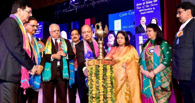 RIPN Mehta and Rashi lighting a lamp at Jaipur in the presence of (from L) PDGs Ajay Kala, Ashok Gupta, PRID Manoj Desai, DGN Ashok Mangal, DG Bina Desai and DGE Rajesh Agarwal.