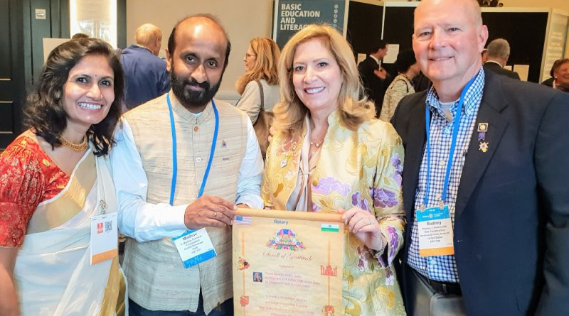 RID 3201 DG Madhav Chandran hands over a scroll of gratitude to DG Beth E Troller. Also in the picture are their spouses Sujata and Rodney.