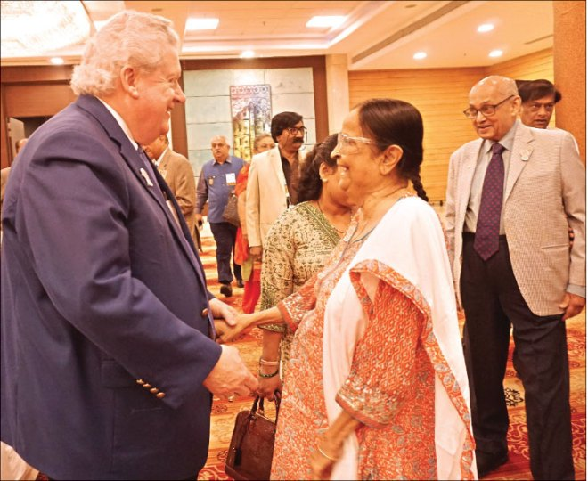 President Maloney in conversation with Binota. PRIP Kalyan Banerjee is also in the picture.