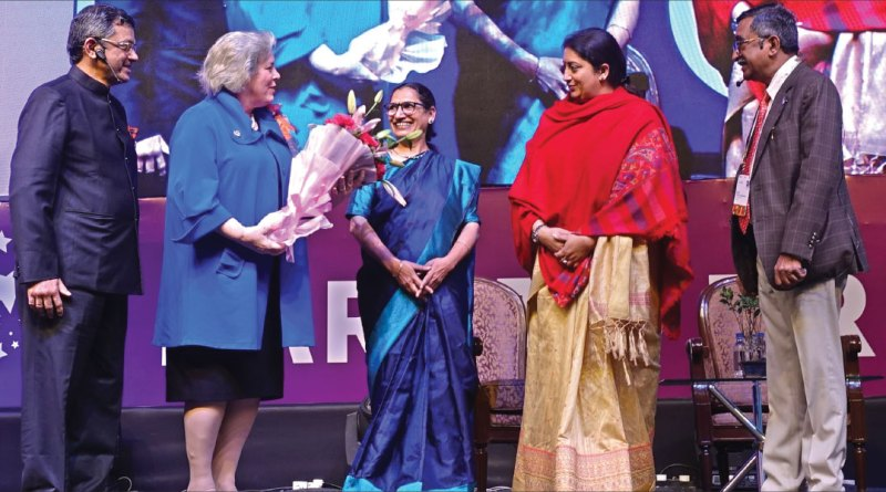 Gay Maloney greets Triveni Acharya, Founder, Rescue Foundation, in the presence of RID Bharat Pandya, Union Minister for Women and Child Development Smriti Irani and Institute Chair T N Subramanian.