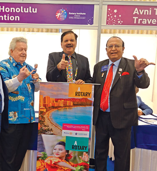 RI President Mark Maloney, Rotary Convention Promotion Committee Chair PRID P T Prabhakar, along with PDG Deepak Shikarpur, at a booth at the Indore Institute inviting Rotarians to register for the Convention scheduled from Jun 6–10 at Honolulu, Hawaii.