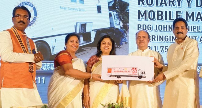 PDG John Daniel and Meera handing over a mammobus for Rotary to RIPN Mehta and Rashi in the presence of DG Shirish Kesavan.