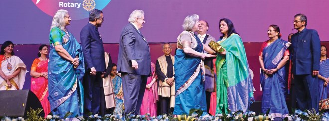 Gay greets Rashi and RIPN Mehta as Sonal, Nayantara Mahajan, Vidhya, Institute Chair Subramanian, Binota, RI President Maloney, PRIP Rajendra Saboo, Madhavi, RID Bharat Pandya and Nalini Prabhakar look on.