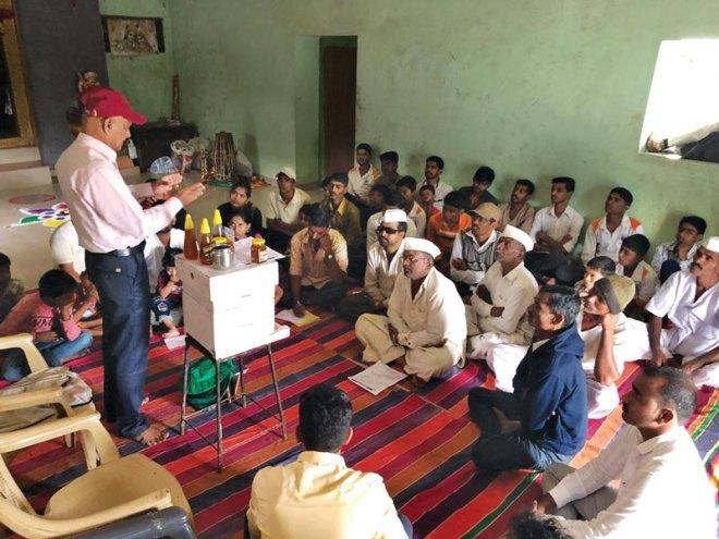 Vijay Mahajan, Founder, Shivsagar Madh Udyog, talking on beekeeping to villagers.