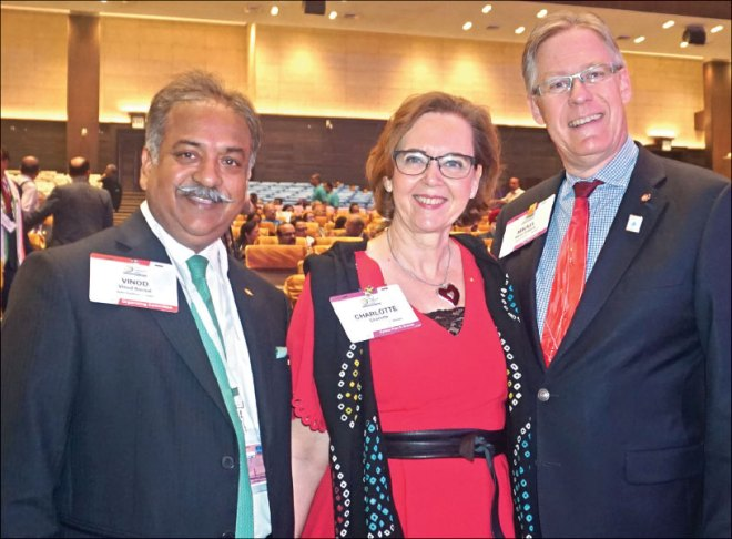 Centennial Summit Chair Vinod Bansal with PRID Mikael Ahlberg and his wife Charlotte.