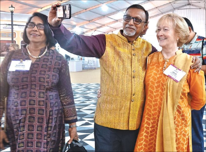 PDG Hitesh Jariwala takes a selfie with TRF Trustee Julia Phelps. His wife Bhishma is on his right.