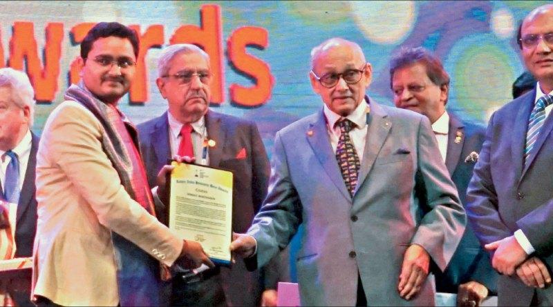 PRIP Kalyan Banerjee honours Bhrigu Borthakur with an award in the presence of RID Kamal Sanghvi, PDG Subhash Jain and RI President Mark Maloney (L).