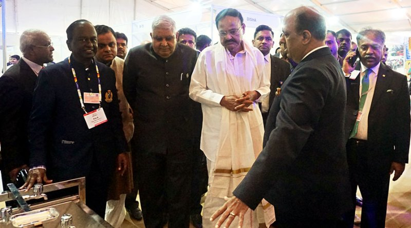 RIPN Shekhar Mehta explains a WinS Project to Vice-President Venkaiah Naidu, West Bengal Governor Jagdeep Dhankhar and State Minister for Science and Technology Bratya Basu at the HoF. Also seen are Centennial Summit Joint Chair Anirudha Roy Chowdhury, HoF Committee Chair V Raja Seenivasan and  Centennial Summit Chair Vinod Bansal.