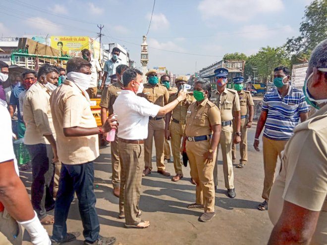 RC Vriddhachalam President A Deepak Chand and his team check the body temperature of police personnel.