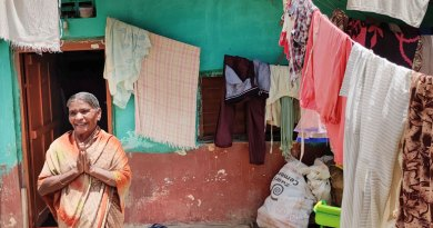 Kamalamma greeting Rotarians in front of her house