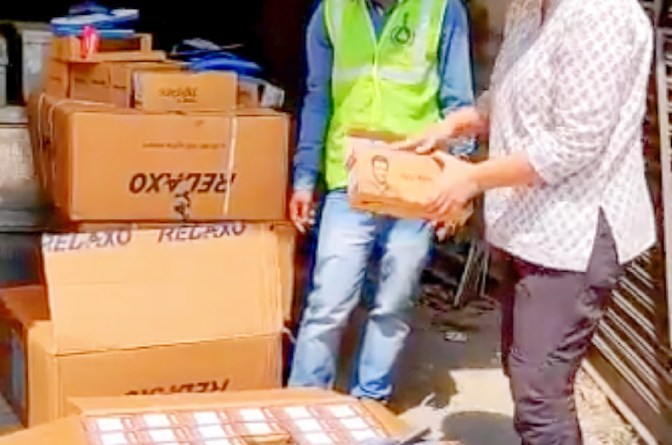 Footwear being organised for migrant workers.
