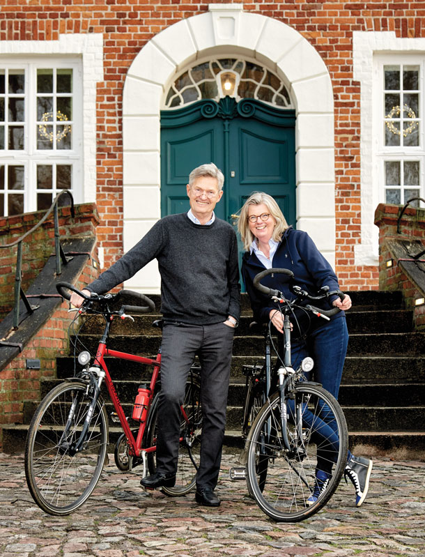 An active couple who enjoy the outdoors, President Knaack and Susanne take a break from bicycling in front of the regional history museum in Ratzeburg.