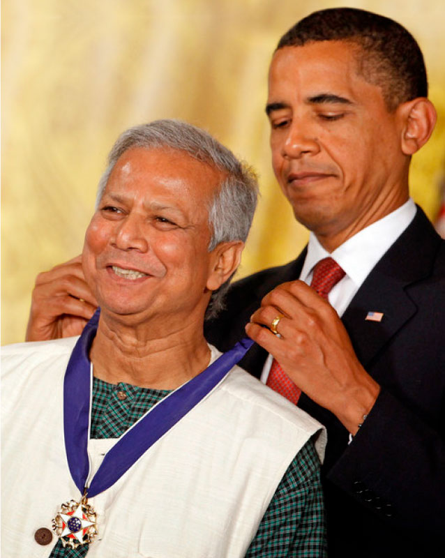 Former US President Barack Obama placing the Presidential Medal of Freedom around Nobel laureate Dr Muhammad Yunus's neck in 2009 at the White House.