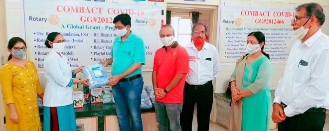 DG Prashant Jani, his wife Hita and AG Mihir Thackar at a PHC in Kachholi to hand over the protective gears.