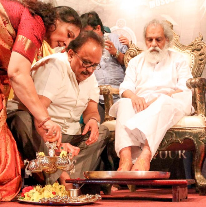 SPB and his wife doing pada puja for KJ Yesudas.