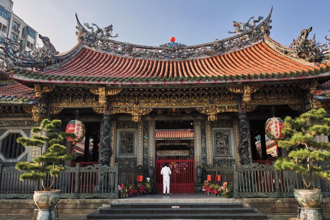 A sensory and religious experience, Lungshan Temple honours folk deities and three systems of belief.