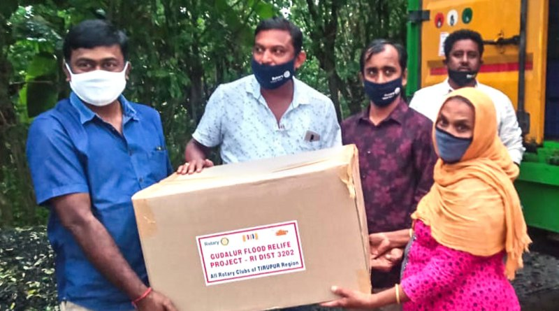Tirupur Rotarians give relief material to a flood victim in Gudalur.