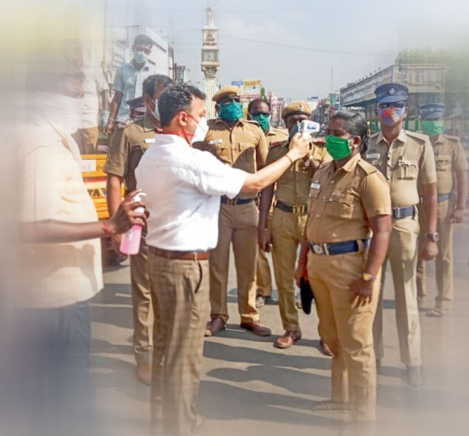 RC Vriddhachalam past president A Deepak Chand and his team check the body temperature of police personnel.