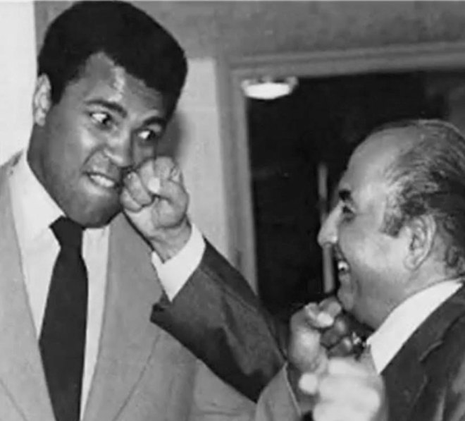 with boxer Muhammad Ali.