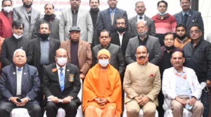 UP CM Yogi Adityanath (centre) with DG Karunesh Kumar Srivastava (second from L) and club members at the Gorakhnath hospital.