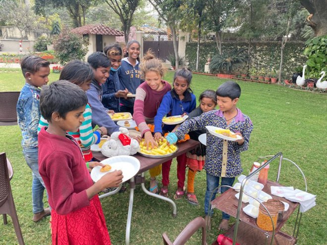 Children enjoy sumptuous lunch at a club member's house.