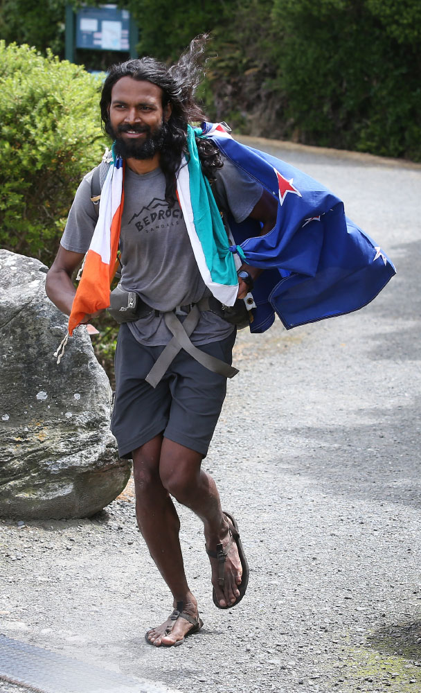 Naresh Kumar approaching the finish line after a 3,300km run in New Zealand.