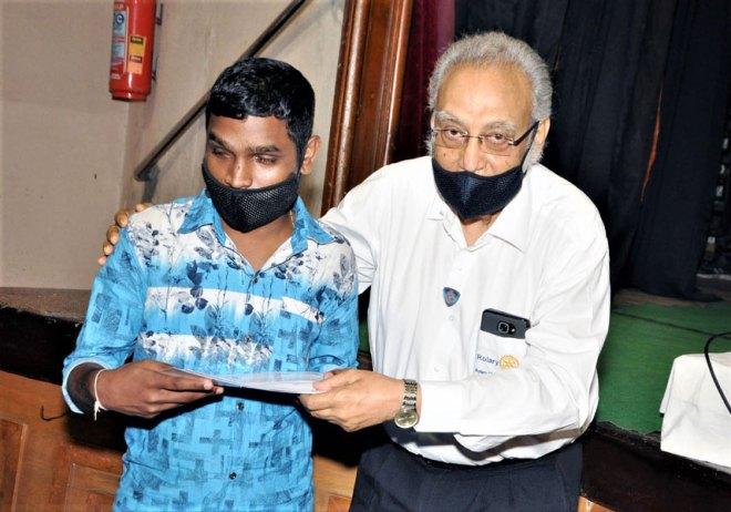 A visually-challenged beneficiary gets an award.