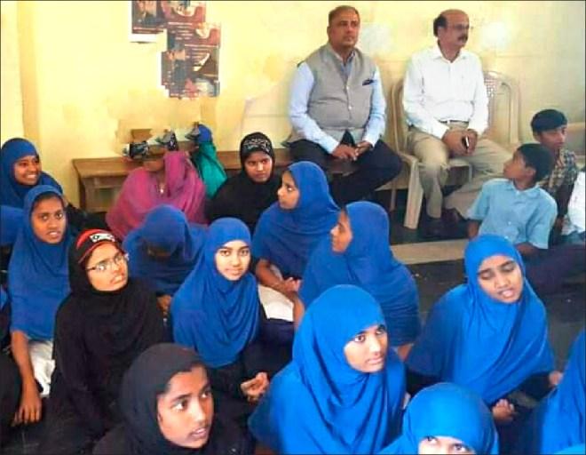 Shekhar Mehta with RID 3020 PDG G V Mohan Prasad at an Urdu medium school where e-learning kits were given.