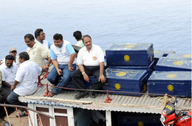 With PDG Ravi Vadlamani on a boat taking Shelter Kits for distribution to flood victims in Andhra Pradesh.