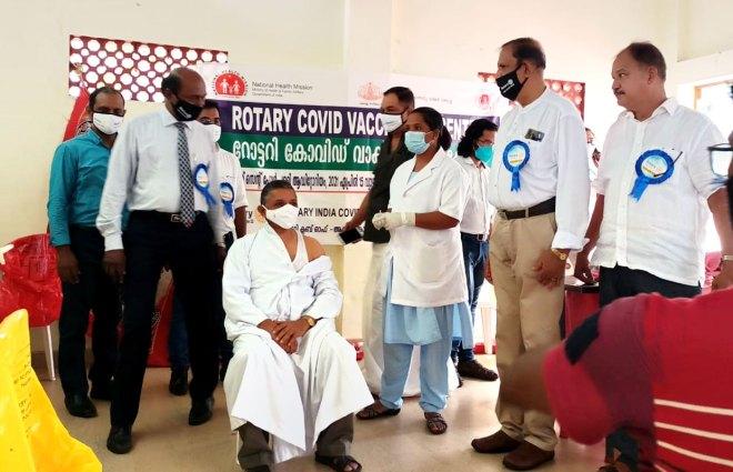 RID 3211 DG Thomas Vavanikunnel (L) visiting a Rotary Covid vaccination centre in Kerala.