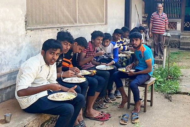 Fresh, home-cooked food being served to Rotaractors helping in construction of check dams.