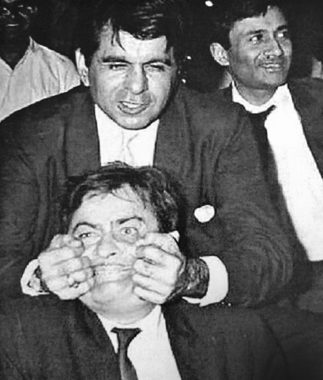 Dilip Kumar with Raj Kapoor and Dev Anand (behind).