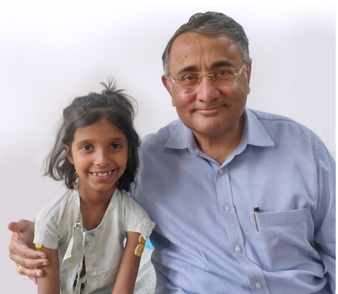 Vivek Gour, trustee, Sri Sathya Sai Health and Education Trust, with a child.