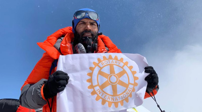 Bhagwan Chawale holding the Rotary flag atop the Mt Annapurna.