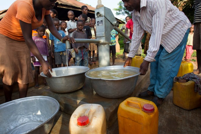 Residents line up for water from the new well in the village of Tonosuano, Ghana.