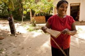 A woman spins coconut fiber into twine to make mats in Nakulugamuwa, Sri Lanka. This business is supported by a Rotary Community Corps (RCC) loan.