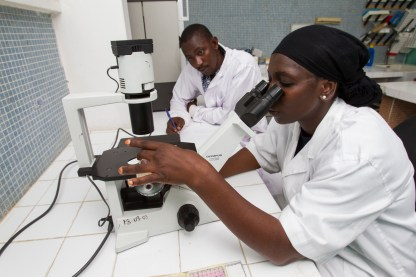 Technicians work in a lab at the Pasteur Institute of Cote d'Ivoire, which monitors for polio.