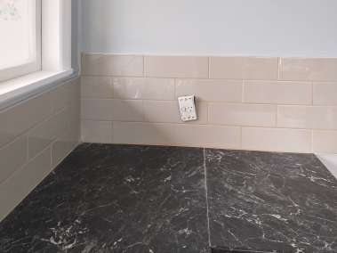 Close up of the tiling in renovated kitchen