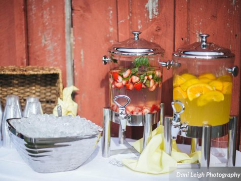 A Water Station is a great way to welcome guests to your ceremony! --- Photo by Dani Leigh Photography.