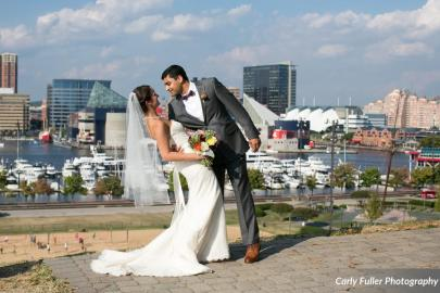 The Baltimore skyline is the perfect backdrop for this ROUGE Bride and Groom. --- Photo courtesy of Carly Fuller Photography.