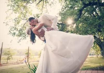 Bride and groom kiss at Rough & Ready Vineyards Nevada County's Favorite Vineyard Wedding Venue